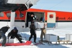 Off-loading of the plane with ice core storage boxes